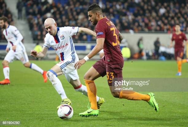Emerson Palmieri of AS Roma and Christophe Jallet of Lyon in action during the UEFA Europa League Round of 16 first leg match between Olympique...