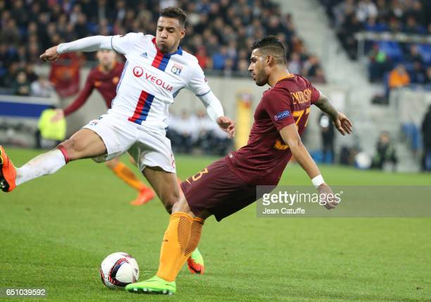 Emerson Palmieri of AS Roma and Corentin Tolisso of Lyon in action during the UEFA Europa League Round of 16 first leg match between Olympique...