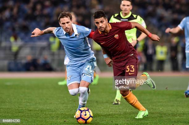 Emerson Palmieri of AS Roma and Lucas Biglia of Lazio fight for the ball during the Italian Cup semifinal match between Lazio and Roma at Stadio...
