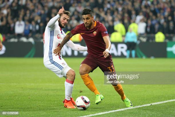 Emerson Palmieri of AS Roma and Lucas Tousart of Lyon in action during the UEFA Europa League Round of 16 first leg match between Olympique Lyonnais...