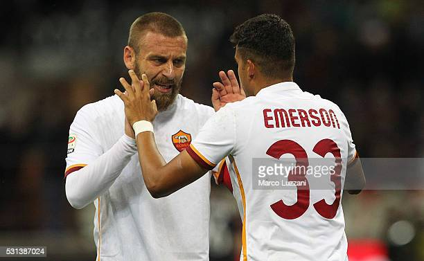 Emerson Palmieri of AS Roma celebrates his goal with his teammate Daniele De Rossi during the Serie A match between AC Milan and AS Roma at Stadio...