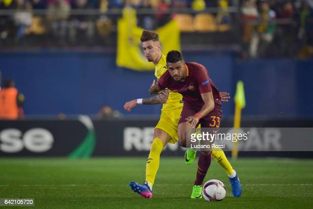 Emerson Palmieri of AS Roma is challenged by Samuel Castillejo of FC Villarreal during the UEFA Europa League Round of 32 first leg match between FC...