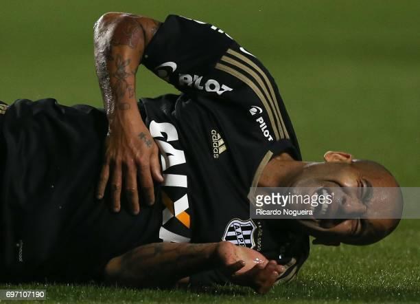 Emerson Sheik 11 of Ponte Preta goes down injured during the match between Santos and Ponte Preta as a part of Campeonato Brasileiro 2017 at Pacaembu...
