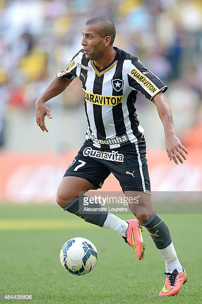 Emerson Sheik of Botafogo runs with the ball during the match between Botafogo and Santos as part of Brasileirao Series A 2014 at Maracana stadium on...
