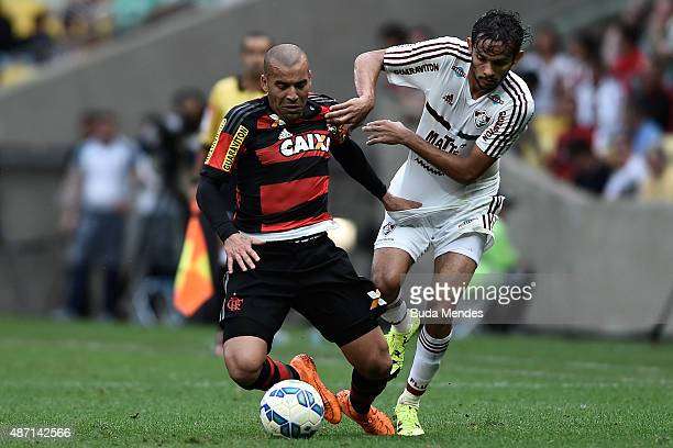 Emerson Sheik of Flamengo battles for the ball with Gustavo Scarpa of Fluminense during a match between Flamengo and Fluminense as part of...
