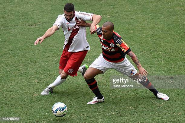Emerson Sheik of Flamengo battles for the ball with Lisandro Lopez of Internacional during a match between Flamengo and Internacional as part of...