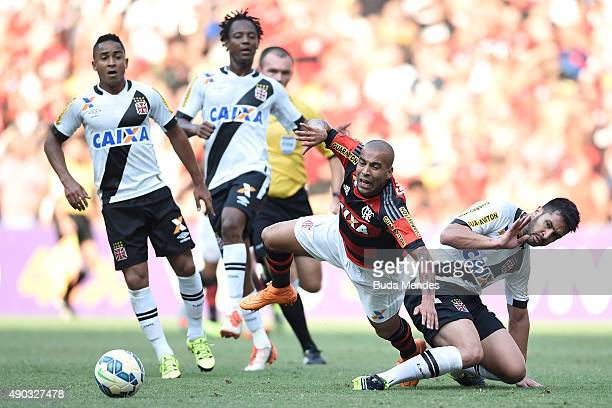 Emerson Sheik of Flamengo battles for the ball with Luan of Vasco during a match between Flamengo and Vasco as part of Brasileirao Series A 2015 at...