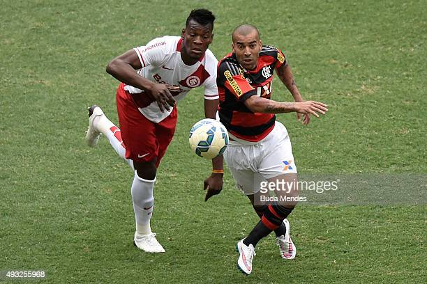 Emerson Sheik of Flamengo battles for the ball with Paulao of Internacional during a match between Flamengo and Internacional as part of Brasileirao...