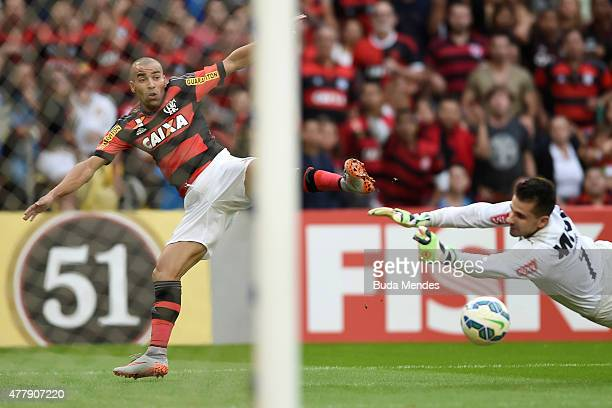 Emerson Sheik of Flamengo struggles for the ball with a goalkeeper Victor of Atletico Mineiro of Atletico Mineiro during a match between Flamengo and...