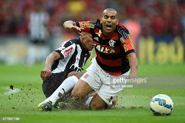 Emerson Sheik of Flamengo struggles for the ball with a Leonardo Silva of Atletico Mineiro during a match between Flamengo and Atletico Mineiro as...