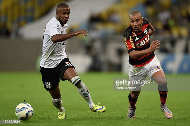 Emerson Sheik of Flamengo struggles for the ball with Fabinho of Figueirense during a match between Flamengo and Figueirense as part of Brasileirao...