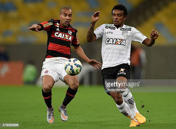 Emerson Sheik of Flamengo struggles for the ball with Paulo Roberto of Figueirense during a match between Flamengo and Figueirense as part of...