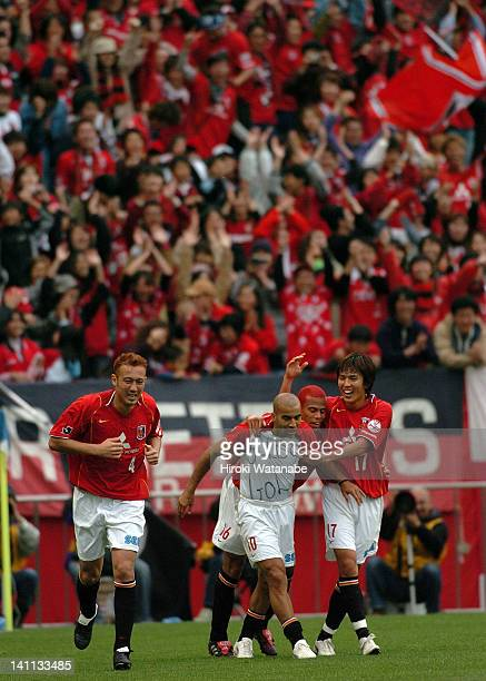 Emerson whose real name is Marcio Passos de Albuquerque of Urawa Red Diamonds celebrates the first goal with his teammates Marcus Tulio Tanaka Santos...