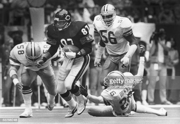 Emery Moorehead of the Chicago Bears heads upfield against Mike Hegman Eugene Lockhart and Michael Downs of the Dallas Cowboys during the game at...