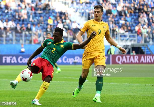 Emest Mabouka of Cameroon clears under pressure form Tomi Juric of Australia during the FIFA Confederations Cup Russia 2017 Group B match between...