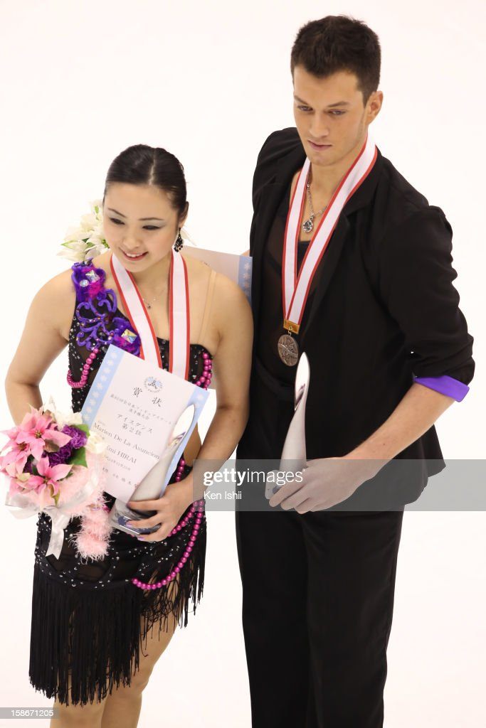 Emi Hirai (L) and Marien De La Asuncion pose for photographs after medal ceremony during day three of the 81st Japan Figure Skating Championships at Makomanai Sekisui Heim Ice Arena on December 23, 2012 in Sapporo, Japan.