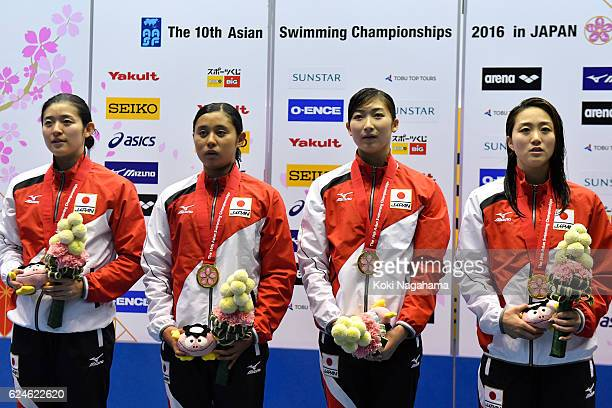 Emi Moronuki and Misaki Sekiguchi and Rikako Ikee and Tomomi Aoki of Japan stand for their national anthem on the podium in 4x100m Medley Relay final...