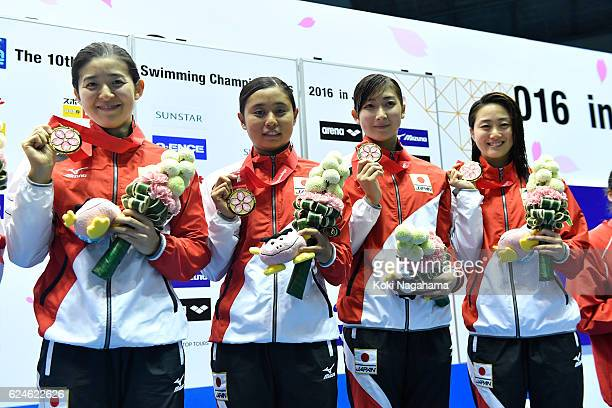 Emi Moronuki and Misaki Sekiguchi and Rikako Ikee and Tomomi Aoki of Japan pose for photographs on the podium in 4x100m Medley Relay final during the...