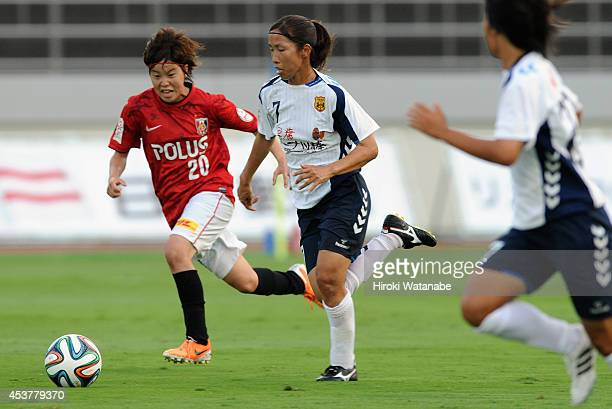 Emi Nakajima of INAC and Chika Kato of Urawa Reds compete for the ball during the Nadeshiko League match between Urawa Red Diamonds Ladies and INAC...