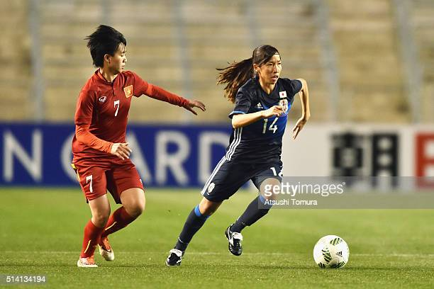 Emi Nakajima of Japan and pvie7 compete for the ball during the AFC Women's Olympic Final Qualification Round match between Vietnam and Japan at...