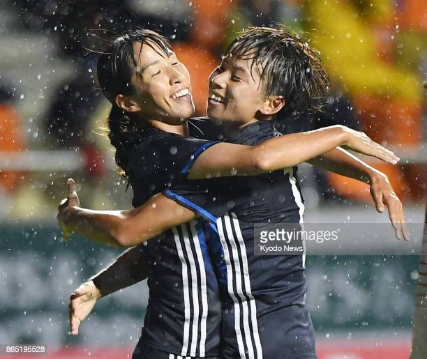 Emi Nakajima of Japan celebrates with her teammate Mina Tanaka after scoring her side's first goal during the second half of an international...