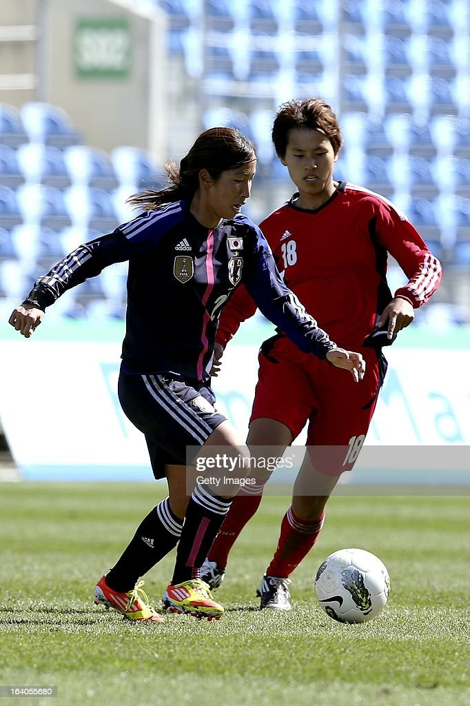 Emi Nakajima of Japan challenges Han Peng of China during the Algarve Cup 2013 fifth place match at the Estadio Algarve on March 13, 2013 in Faro, Portugal.