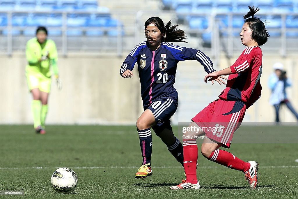 Emi Nakajima of Japan challenges Lei Jiahui of China during the Algarve Cup 2013 fifth place match at the Estadio Algarve on March 13, 2013 in Faro, Portugal.