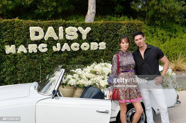 Emi Renata Sakamoto and Lewis Tan attend Marc Jacobs Fragrances and Kaia Gerber Celebrate DAISY on May 9 2017 in Beverly Hills California