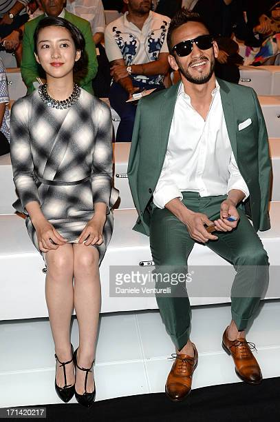 Emi Takei and Hidetoshi Nakata attend the Gucci show during Milan Menswear Fashion Week Spring Summer 2014 show on June 24 2013 in Milan Italy
