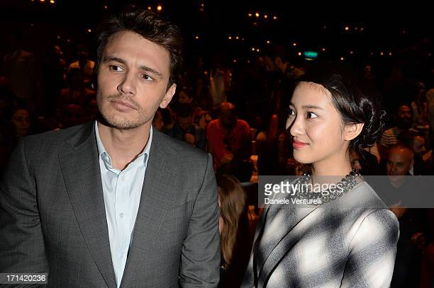 Emi Takei and James Franco attend the Gucci show during Milan Menswear Fashion Week Spring Summer 2014 show on June 24 2013 in Milan Italy