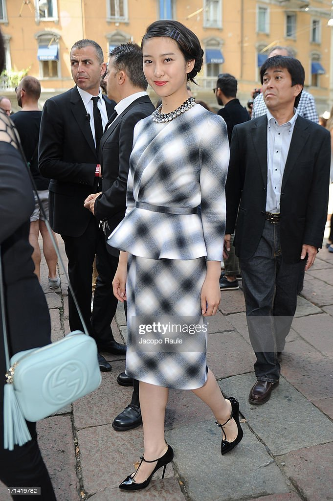 Emi Takei attends the Gucci show during Milan Menswear Fashion Week Spring Summer 2014 show on June 24, 2013 in Milan, Italy.