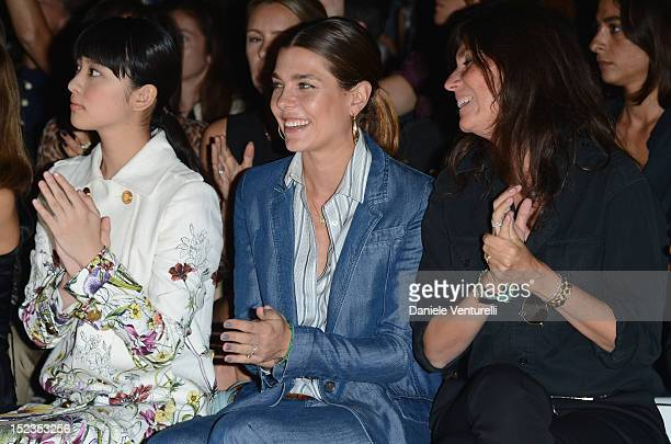 Emi Takei Charlotte Casiraghi and Editor in Chief of French Vogue Emmanuelle Alt attend the Gucci Spring/Summer 2013 fashion show as part Milan...