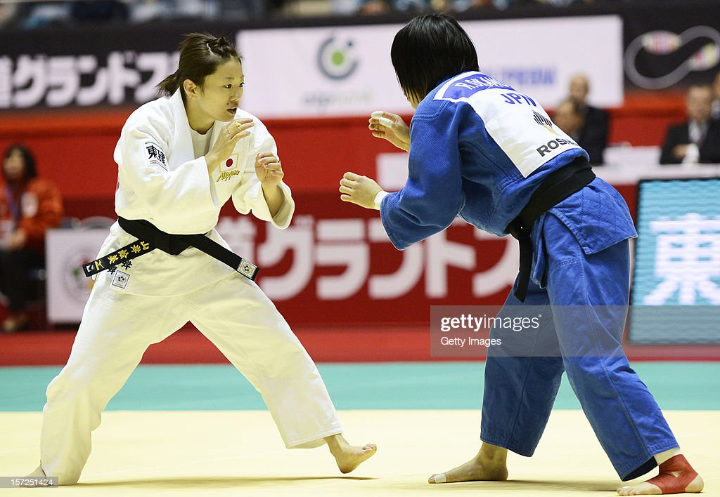 Emi Yamagishi (L) and Riho Okamoto of Japan compete in the Women's 48kg first round match during day one of the Judo Grand Slamat Yoyogi Gymnasium on November 30, 2012 in Tokyo, Japan.