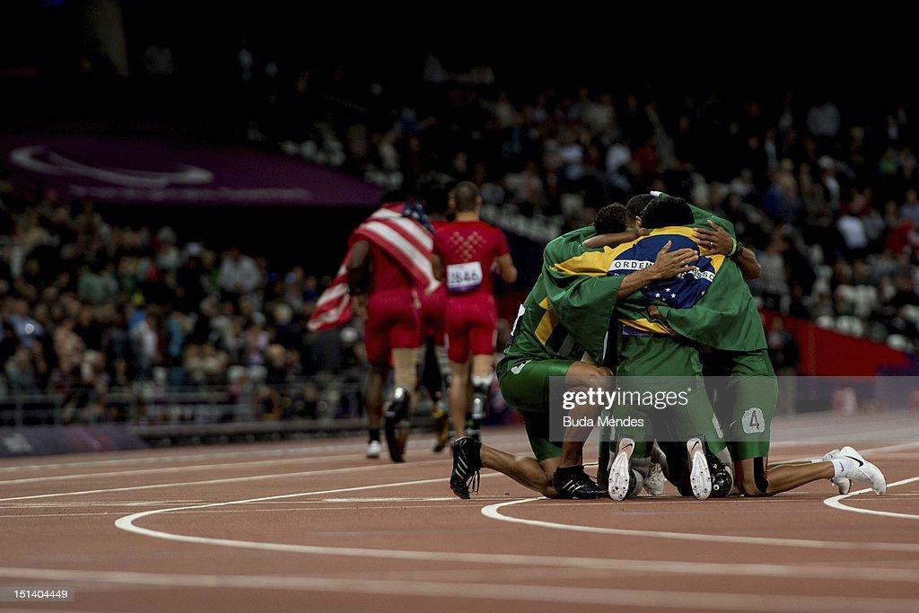Emicarlo Souza, Yohansson Nascimento, Antonio Souza and Alan Fonteles Cardoso Oliveira huddle after the Men's 4x100m relay T42/T46 Final on day 7 of the London 2012 Paralympic Games at Olympic Stadium on September 5, 2012 in London, England.