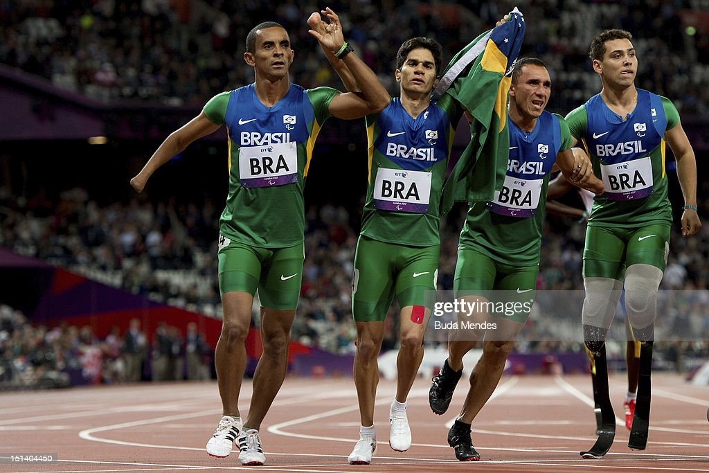 Emicarlo Souza, Yohansson Nascimento, Antonio Souza and Alan Fonteles Cardoso Oliveira celebrate after the Men's 4x100m relay T42/T46 Final on day 7 of the London 2012 Paralympic Games at Olympic Stadium on September 5, 2012 in London, England.