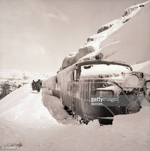 1/19/1952 Emigrant Gap CA Blocked by heavy snowdrifts after a fierce blizzard in the Sierras the streamliner 'City of San Francisco' is finally...