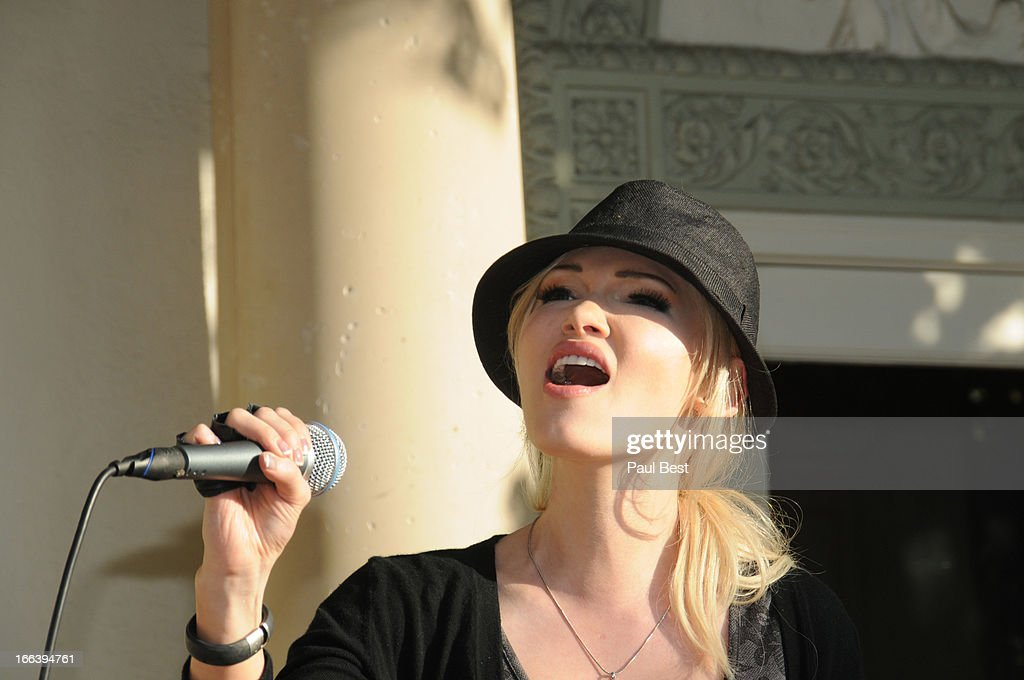 Emii performs at 3rd Annual Rockn Rolla Movie Awards Eco Party on April 11, 2013 in Los Angeles, California.