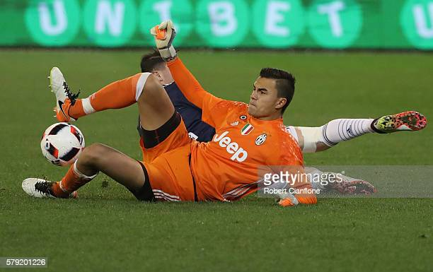 Emil Audero of Juventus is challenged by George Howard of Melbourne Victory during the 2016 International Champions Cup Australia match between...