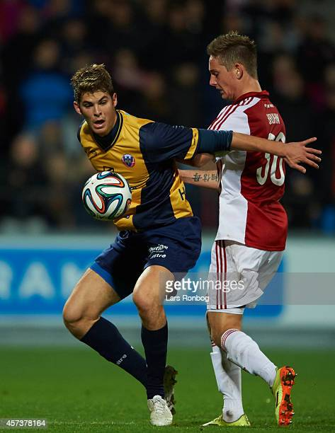 Emil Berggreen of Hobro IK and Andreas Bruhn of AaB Aalborg compete for the ball during the Danish Superliga match between AaB Aalborg and Hobro IK...