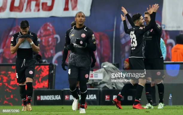 Emil Berggreen of Mainz jubilates with team mates after scoring the fourth goal during the Bundesliga match between RB Leipzig and 1FSV Mainz 05 at...