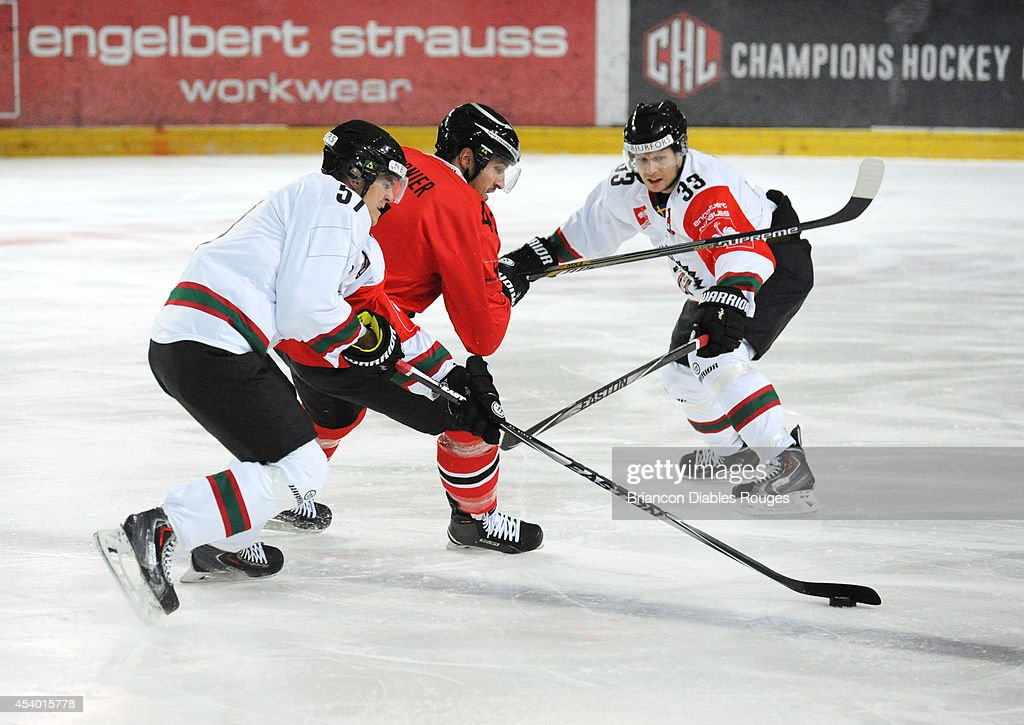 Emil Djuse and #33 Elias Falth of Frolunda Gothenburg track defensively during the Champions Hockey League group stage game between Briancon Diables Rouges and Frolunda Gothenburg on August 23, 2014 in Briancon, France.