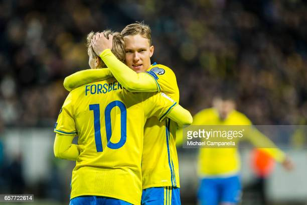 Emil Forsberg and Ludwig Augustinsson of Sweden embrace after the 20 goal during the FIFA 2018 World Cup Qualifier between Sweden and Belarus at...