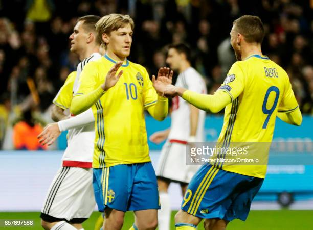 Emil Forsberg and Marcus Berg of Sweden celebrate after scoring during the FIFA 2018 World Cup Qualifier between Sweden and Belarus at Friends arena...