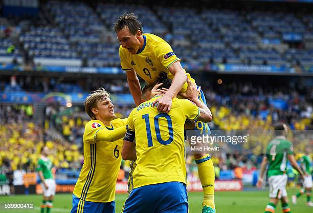 Emil Forsberg John Guidetti Zlatan Ibrahimovic and Kim Kallstrom of Sweden celebrate their team's first goal during the UEFA EURO 2016 Group E match...