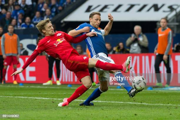 Emil Forsberg of Leipzig and Benedikt Hoewedes of Schalke battle for the ball during the Bundesliga match between FC Schalke 04 and RB Leipzig at...