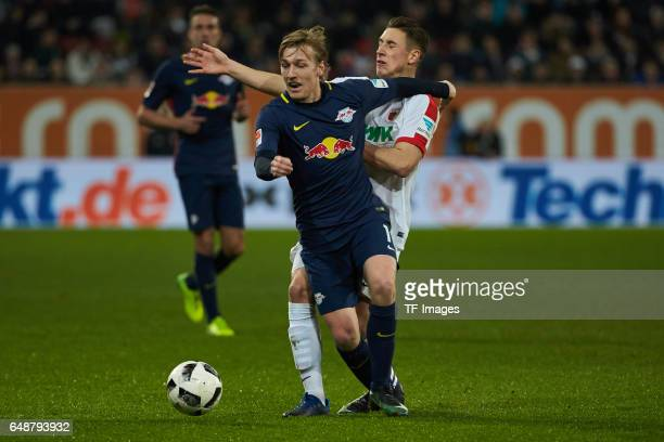Emil Forsberg of Leipzig and Dominik Kohr of Augsburg battle for the ball during the Bundesliga match between FC Augsburg and RB Leipzig at WWK Arena...