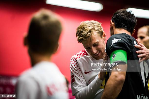 Emil Forsberg of Leipzig and Lars Stindl of Moenchengladbach shake hands in the player tunnel prior to the Bundesliga match between RB Leipzig and...