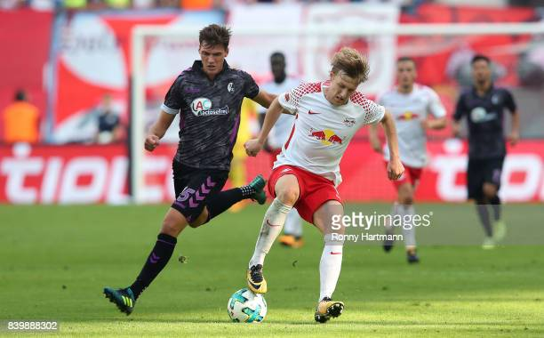 Emil Forsberg of Leipzig and Pascal Stenzel of Freiburg vie during the Bundesliga match between RB Leipzig and SportClub Freiburg at Red Bull Arena...