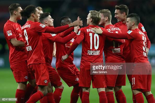 Emil Forsberg of Leipzig and tea mates celebrate after Julian Baumgartlinger of Leverkusen scored an own goal during the Bundesliga match between...