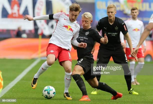 Emil Forsberg of Leipzig battles for the ball with Andreas Beck of Stuttgart during the Bundesliga match between RB Leipzig and VfB Stuttgart at Red...